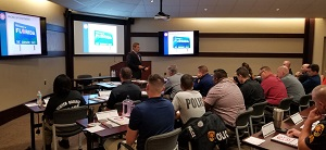 Image of police officers sitting in classroom learning
