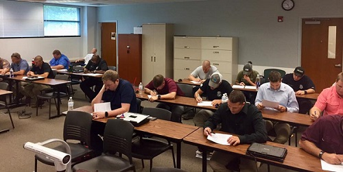 Picture of officers taking their end of training test