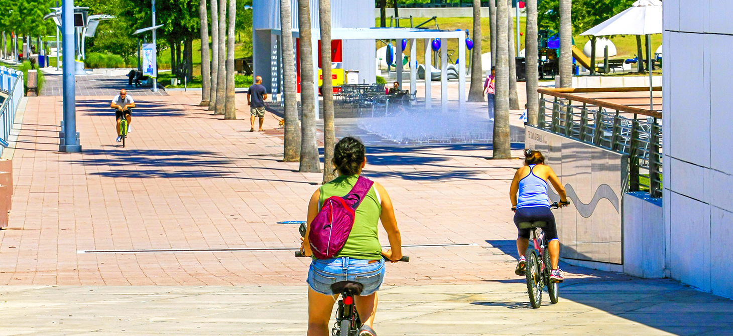 People on bicycles cycling on the Riverwalk in downtown Tampa, Florida