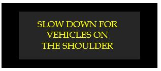 slow down for vehicles on the shoulder